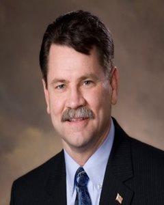 Mark E. Newcomb